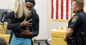 Slain Man's Brother Hugs And Forgives Sentenced Female Cop