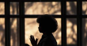 """alt=""""image showing black woman in a church"""""""