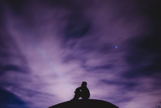 """alt=""""image showing man alone on a hill at night"""""""